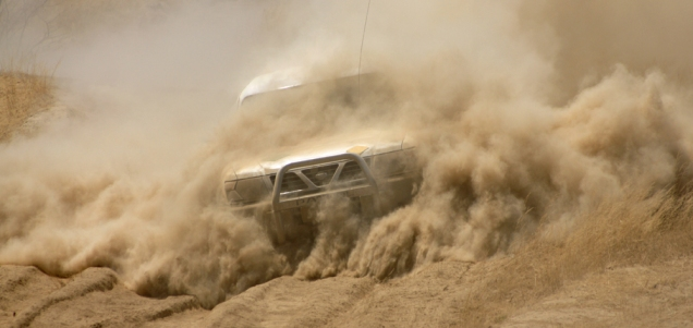 A Nissan Patrol negotiating the thick dust of the Khowarib